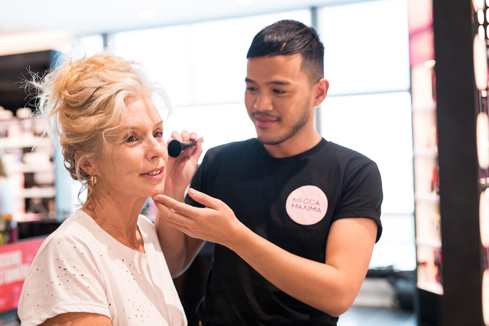 Professional makeup application at Mecca Maxima, Domestic Terminal, Brisbane Airport