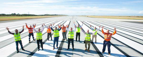 The new runway landed under budget at $1.1 billion