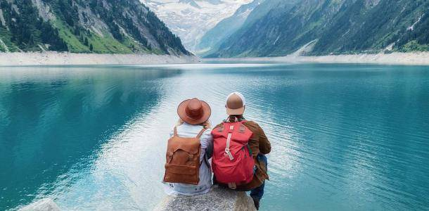 What to do with your holiday photographs - traveller couple looking out over mountain and lake | BNE Traveller Tips: What to do with your holiday photographs